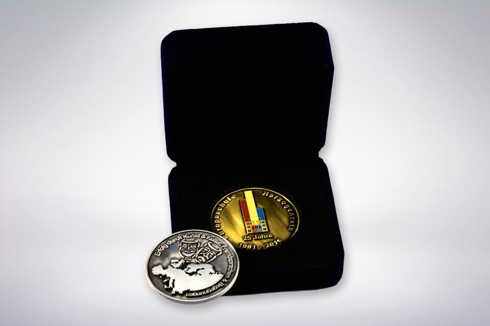 Zander Papier & Pokale Referenzen Medaille Europaschule Herzogenrath