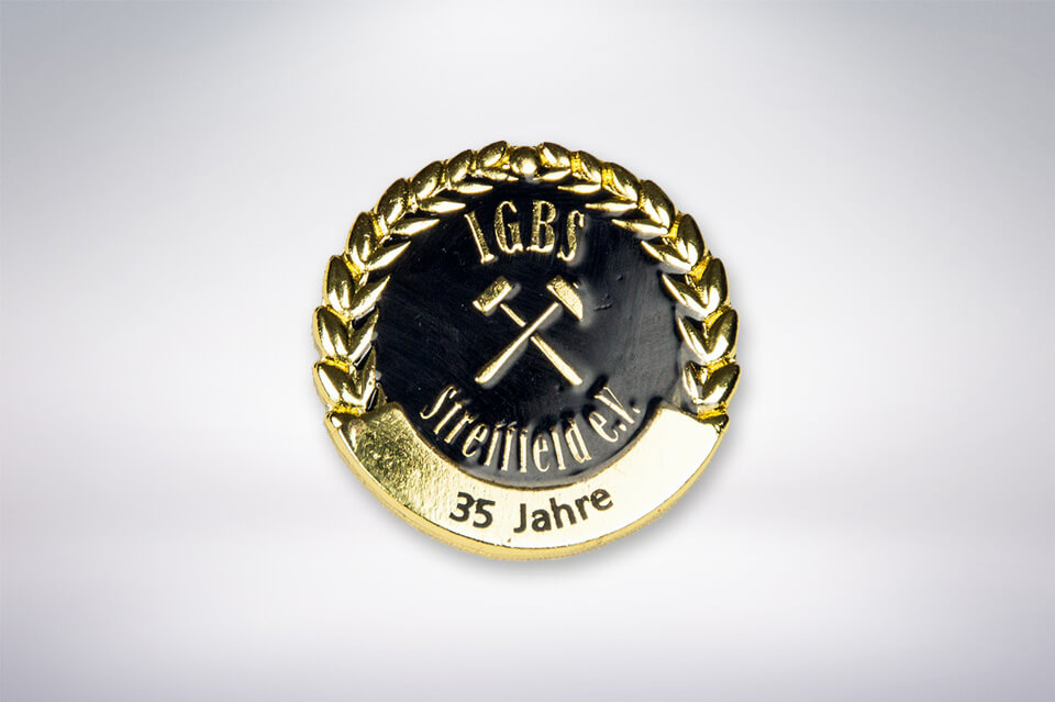 Zander Papier & Pokale Referenzen Pin IGBS Streitfeld